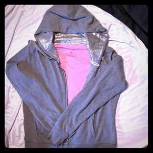 Gray zip up hoodie and pink under shirt